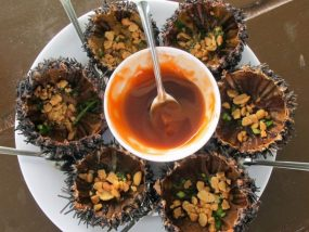 Grilled Sea urchin with grease and spring onion